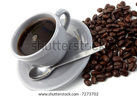 Grey cup of coffee with beans over white background