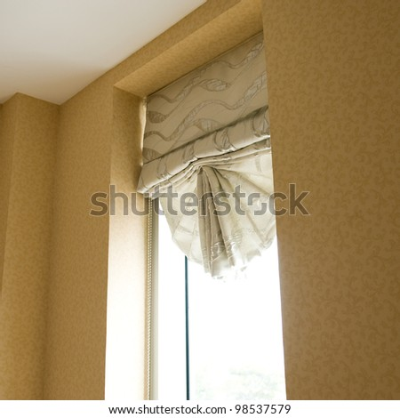 grey curtain in a room, with windows open - stock photo