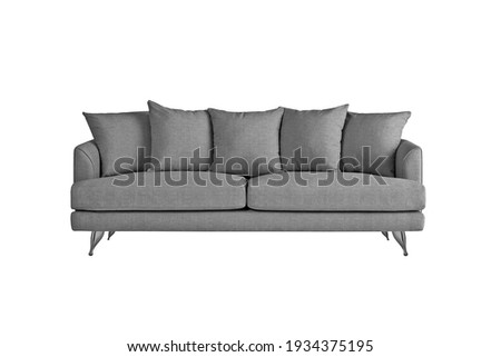 Grey fabric sofa on brushed metal legs with pillows isolated on white background. Series of furniture Foto stock ©