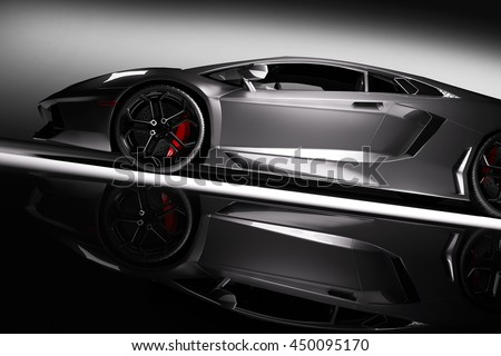 Grey fast sports car in spotlight, black background. Shiny, new, luxurious. 3D rendering