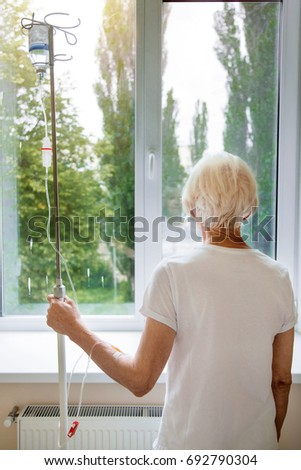 Grey haired delicate woman hoping getting better soon #692790304