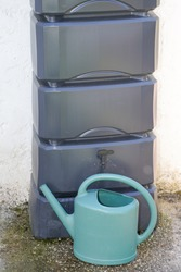grey home rainwater and green watering can