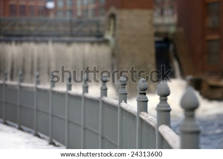 Grey iron fencing against houses in the winter
