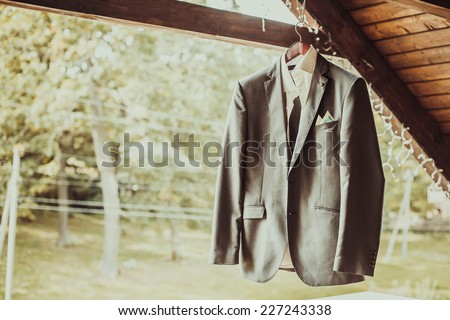 Grey jacket on wooden background