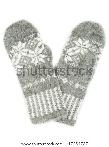 Grey knitted gloves with a pattern of snowflakes isolated on white background