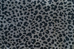 Grey leopard pattern. Spotted animal print as background.
