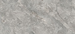 Grey marble texture shot through with subtle white veining