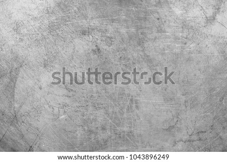 Grey metal texture. Scratched metal. Design Background.