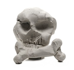 Grey modelling clay shaped in skull sculpture isolated on white background