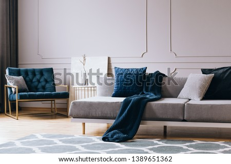 Grey monochrome living room interior with blue accents