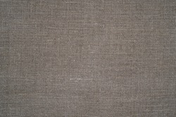 Grey natural linen texture as background. Grey fabric background. Linen fabric background.