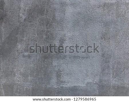 grey painting on masonry wall.