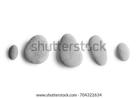 Grey pebbles isolated on white background