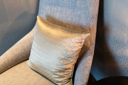 Grey pillow on the grey chair