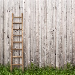 grey plank wall with wooden ladder background