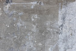 Grey plastered brick wall texture. Grey painted retro wall built structure. Grungy shabby uneven painted plaster. Abstract grey wash background. Design element.