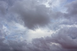Grey purple high layered grey epic clouds on sky. Heaven cloudscape air view