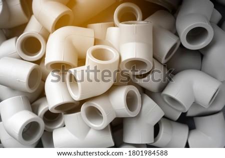 Grey pvc plumbing pipes corners background closeup Foto stock ©