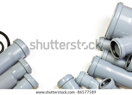 Grey PVC sewer pipes on white background
