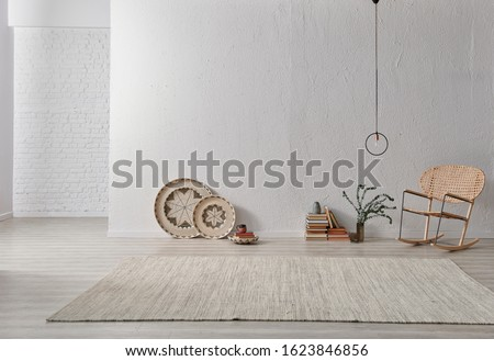 Grey room stone wall, home object chair and lamp, white brick background, carpet on the parquet.