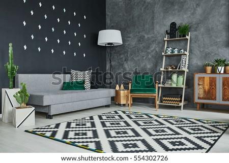 Grey room with blackboard wall, cactus and sofa #554302726