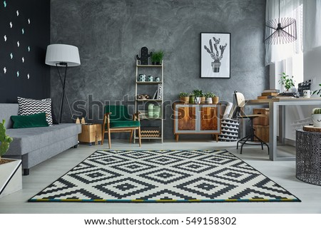 Grey room with pattern carpet and wooden furniture #549158302