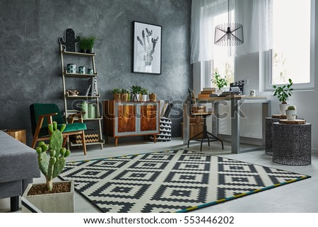 Grey room with window, carpet, dresser and table #553446202