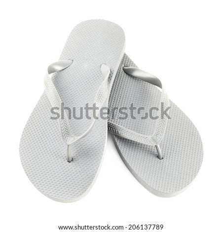 Grey rubber flip-flops isolated over white background