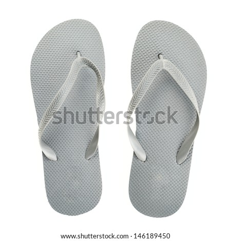 Grey rubber flip-flops isolated over white background, pair shot above