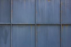 Grey rusty metal slide door background located in Thailand.