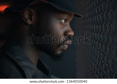 43331c34011 Grey shades profile portrait of young man with beard