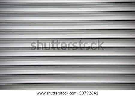 grey shutters over a shop doors