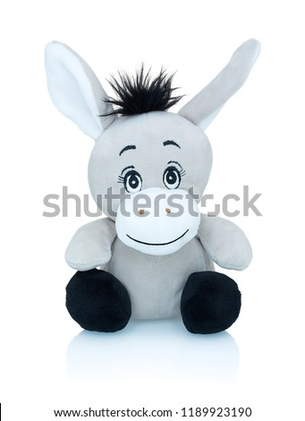 Grey smiling donkey plushie toy isolated on white background with shadow reflection. African wild ass plaything isolated on white underlay. Jackass plush stuffed puppet on white backdrop.