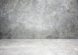 Grey stone grungy stage,empty room background,free space interior.Cement wall.Advertisement design studio.Modern backdrop.