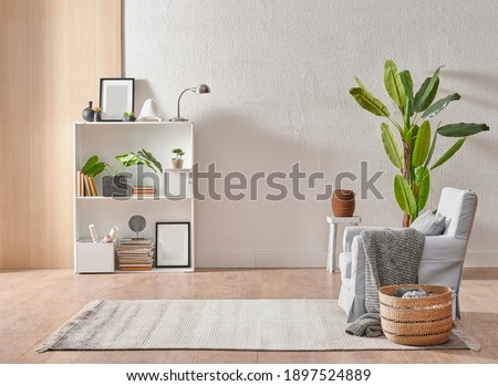 Grey stone wall interior room with wooden decor, bookshelf, sofa and vase of plant, middle table, carpet, home decoration. Foto stock ©