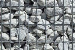 Grey stones in Gabion  Wall, Baskets, wire fence filled with stones background