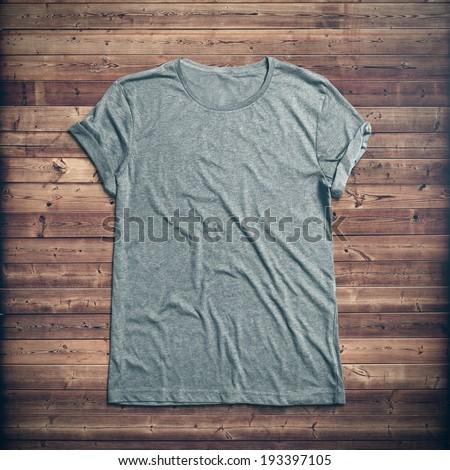 Grey t-shirt on wood background #193397105