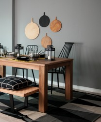 grey wall chopping board and wooden table black pillow black lantern with black white modern kitchen dining room corner