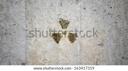 Grey wall with radioactivity symbol. Background image