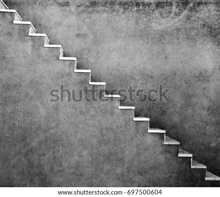 Grey wall with stairs texture background, minimalistic style for base image for posters, banners or covers, trivial design and simplicity is a trendy key for graphic arts, black and white monochrome