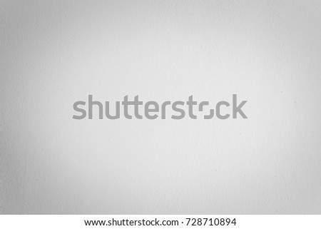 Grey,white cement wall texture background,empty gray blank wall room interior and soft light circular well use as background for montage or display product or text promote goods on free background.