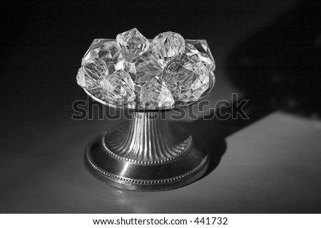Greyscale image of diamonds on a pedestal with interesting shadow.