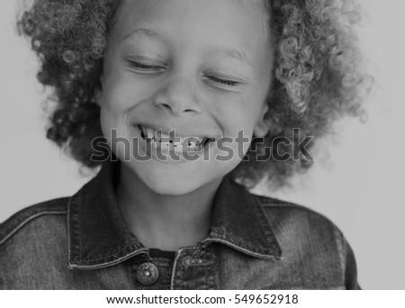 Greyscale mixed race kid smiling eyes closed #549652918