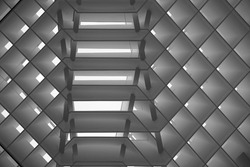 Grid structure of roof or ceiling. Minimalist architecture of modern building. Technological grid with parallel lines. Abstract geometric background on construction industry or technology.