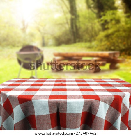 grill and red tablecloth
