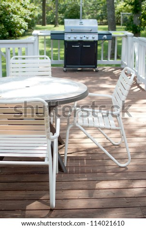 Grill and table on porch deck