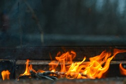 Grill, BBQ, fire, charcoal barbecue, closeup. actively smoldering embers of fire