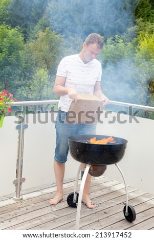 Grill master when igniting the fire of the grill #213917452