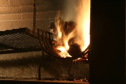 Grill on heating the coal while the sparks fly with their characteristic noise lighting up the night in Argentina