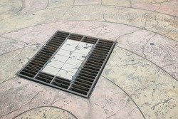 Grille drain of sewer around the street or walkway . Water recirculation system. Wastewater treatment.